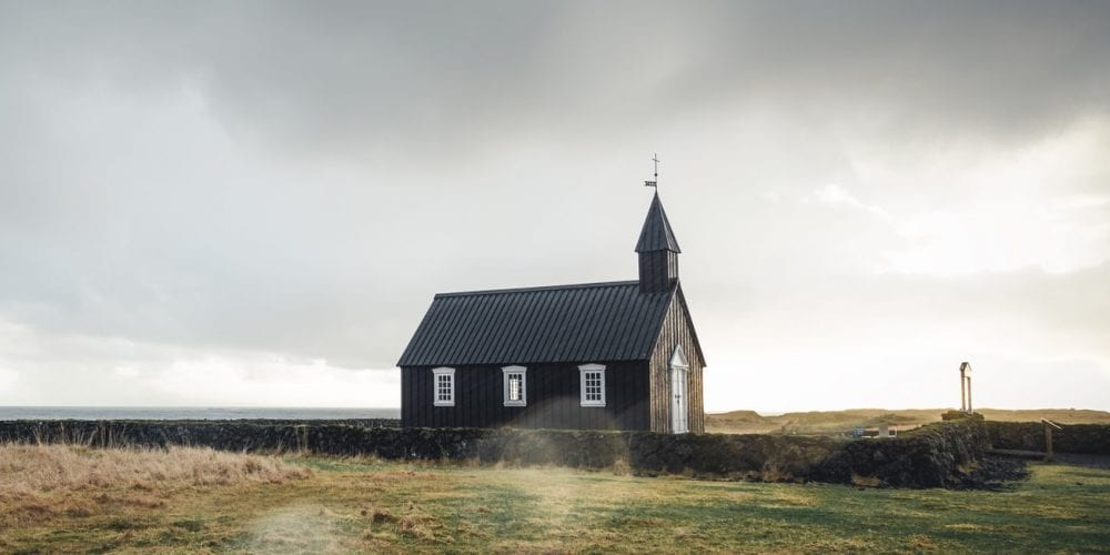 Brown Church in Field with Cemetery