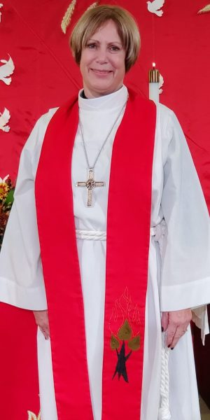 Bishop Joy in front of altar at her installation